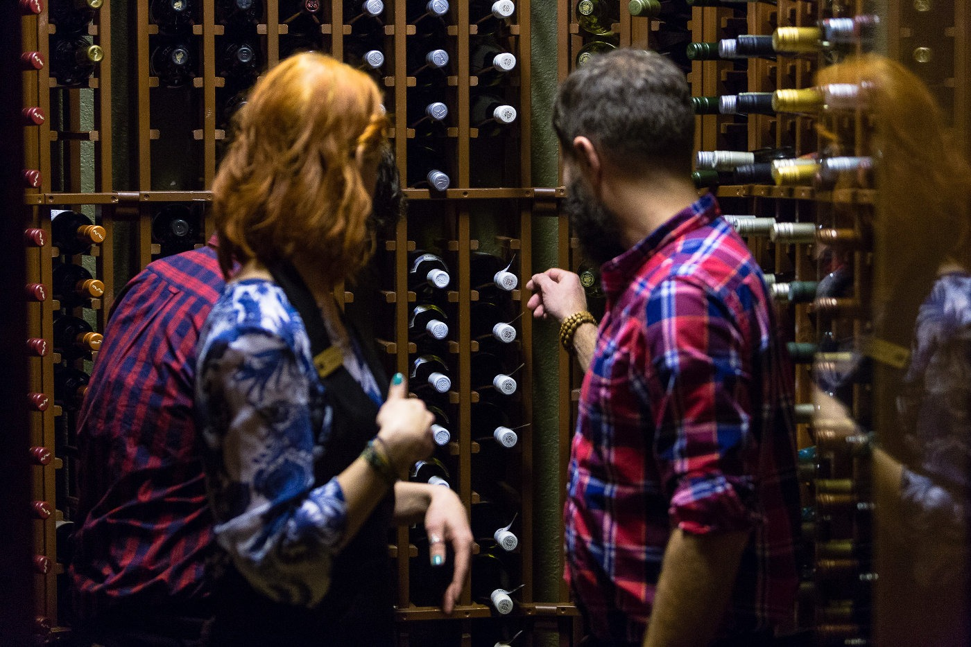 Two people selecting wine in in the cellar